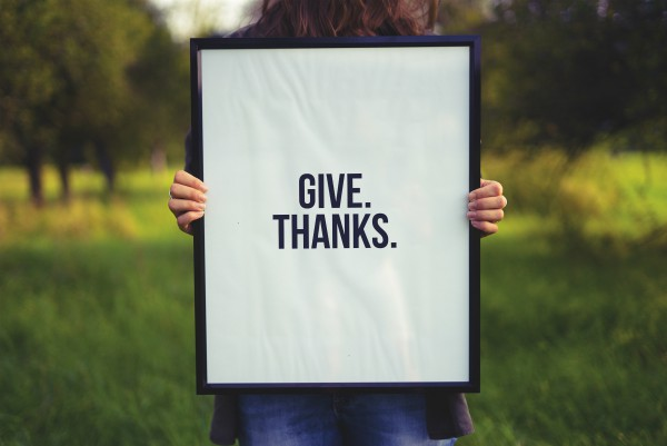Hands holding sign reading give thanks | What is Happiness and One Simple Way to Expand Your Joy
