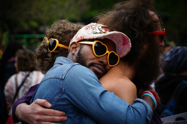 friends hugging in heart-shaped sunglasses | The Science of Happiness: How to Focus on Friendship