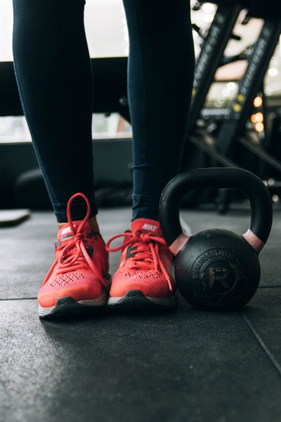 red sneakers and black kettlebell | Make Good Mornings: How to Master Your A.M. Routine https://positiveroutines.com/tips-for-good-mornings/