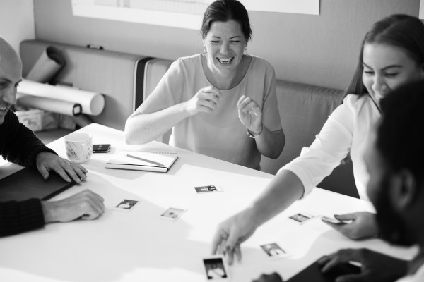 black and white image of coworkers collaborating | Make the Power of Kindness Work for You