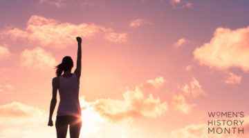 woman in front of sunset fist up power | 14 Quotes by Women to Inspire and Motivate You