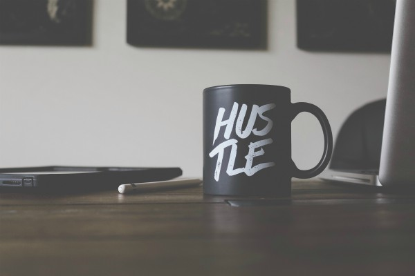 coffee cup on desk says hustle | 17 Quotes about Working Hard You Should Live By