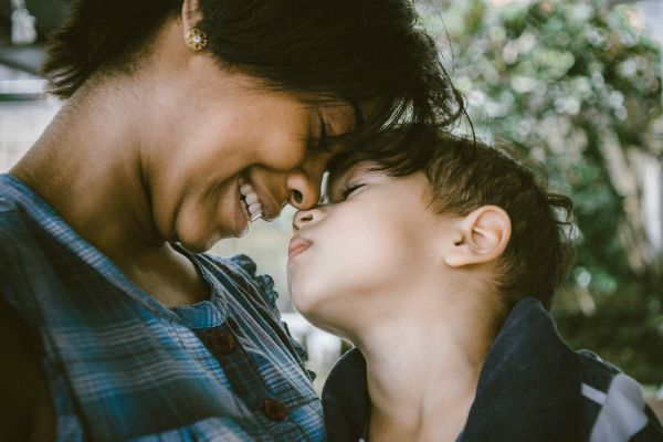 black mom pressing face to child | 10 Expert-Approved Gratitude Messages for Mom