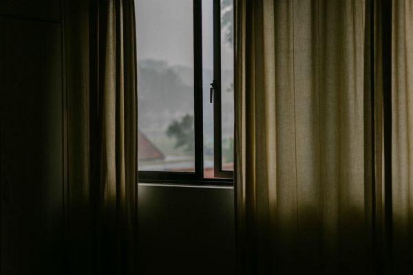 dark curtains against window | An Adult Bedtime Routine for the Best Sleep Ever https://positiveroutines.com/bedtime-routine-for-adults/