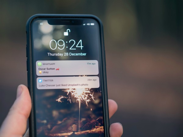 iphone displaying notification in someone's hand | Here's How to Find Motivation: Don't. Try This Instead. http://www.positiveroutines.com/how-to-find-motivation