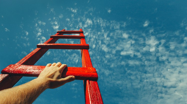 mans hand climbing red letter to sky | Here's How to Find Motivation: Don't. Try This Instead. https://positiveroutines.com/how-to-find-motivation