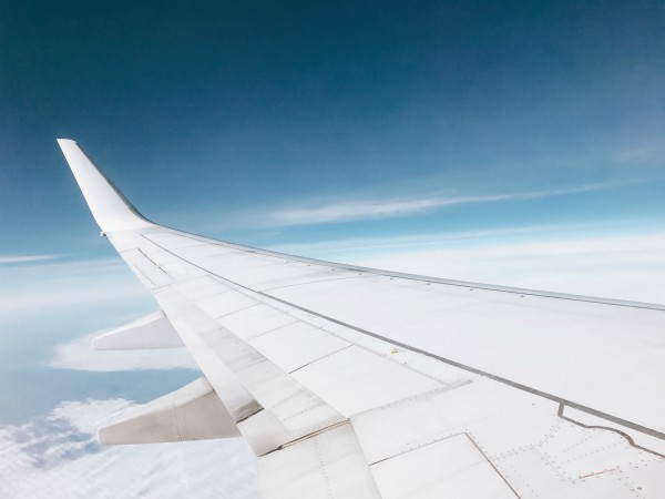 wing of plane looking over sky | 10 Expert-Approved Gratitude Messages for Mom