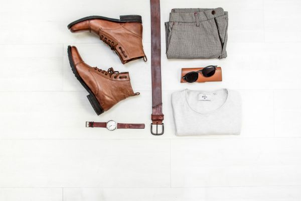 top view of man's clothes laid out brown boots white shirt watch | 11 Good Father's Day Gifts to Make Dad More Productive https://positiveroutines.com/good-fathers-day-gifts-2018/