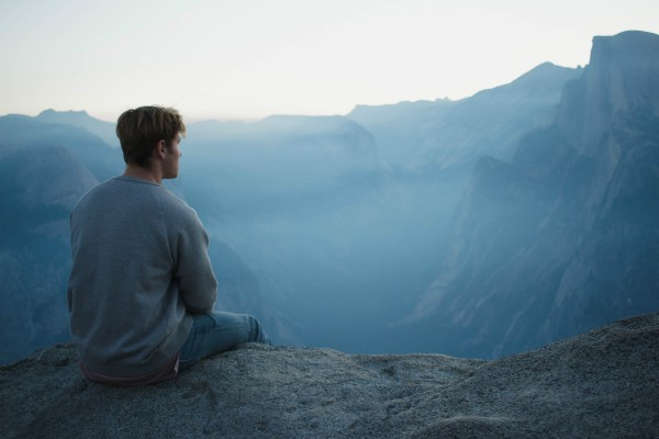 man looking over mountains | Why You Need to Try Loving-Kindness Meditation https://positiveroutines.com/loving-kindness-meditation/