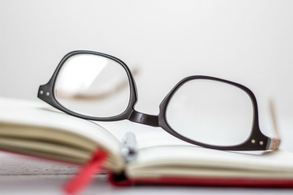 glasses on open notebook | Yes, You Can Stop Procrastinating. Here's How. https://positiveroutines.com/stop-procrastinating/