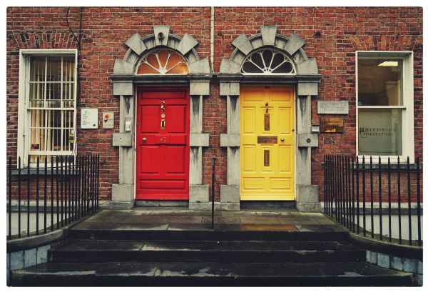 brick building with one red door one yellow door choice concept | In Time for the Holidays: How to Take Breaks Effectively https://positiveroutines.com/how-to-take-breaks/