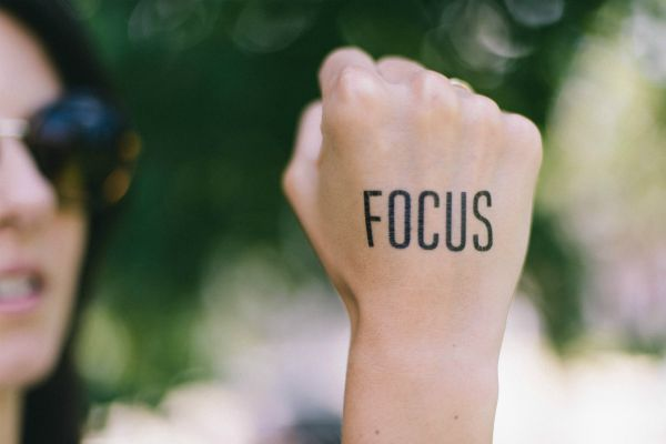 focus written on a woman's fist | In Time for the Holidays: How to Take Breaks Effectively https://positiveroutines.com/how-to-take-breaks/