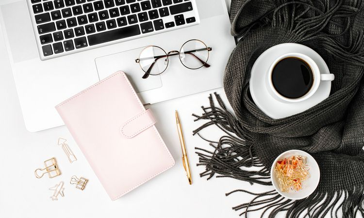laptop planner with blanket glasses coffee fall concept | No Distractions: 5 Ways to Focus This Fall