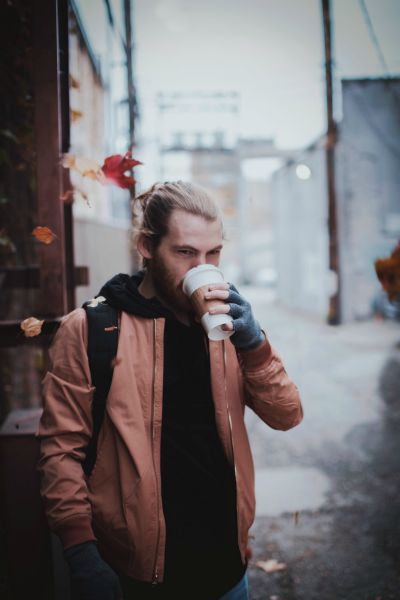 man drinking coffee as leaves fall | 5 Morning Routine Ideas to Make You Scarily Successful