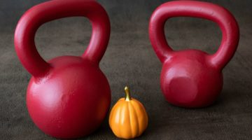 two red kettlebells with mini pumpkin | A Quick and Easy HIIT Routine for Halloween https://positiveroutines.com/easy-hiit-routine/