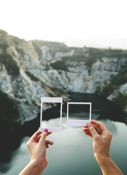 hands holding polaroid pictures over rock quarry | 5 Simple Steps to Feeling Grateful Right Now https://positiveroutines.com/feeling-grateful/