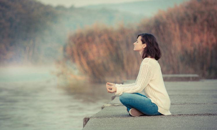 woman sitting outside in fall meditating | [Video] This is the Gratitude Meditation You Need This Fall  https://positiveroutines.com/gratitude-meditation/