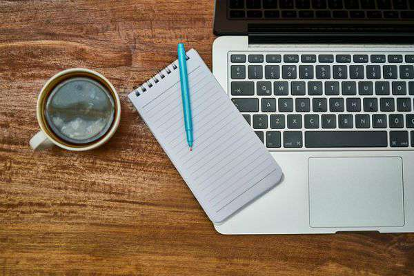 cup of coffee notepad and laptop on desk | A Healthy Morning Routine For The Best 2019 https://positiveroutines.com/healthy-morning-routine/