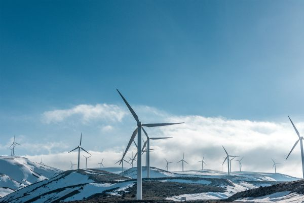 wind turbines on snowy mountain daytime | The Happiest Stories of 2018 to Get You in The Spirit https://positiveroutines.com/happiest-stories/