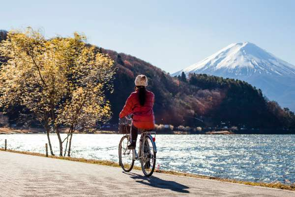 female riding bike near lake| 11 Productive Things to do With Your Free Time https://positiveroutines.com/productive-things-to-do/