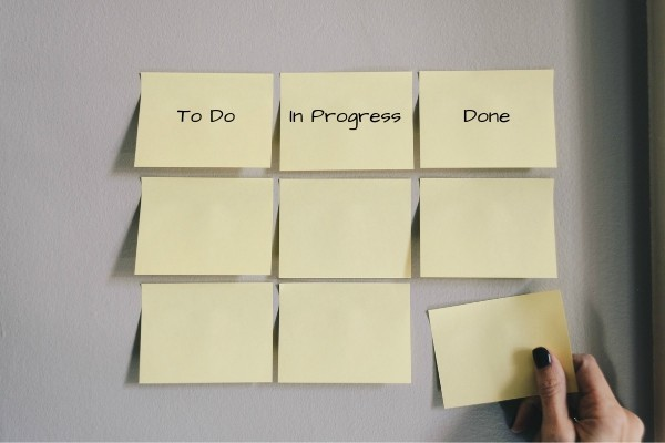 sticky notes on wall presenting to do lists | How to Work Remotely + Why You Should Try It This Year https://positiveroutines.com/how-to-work-remotely/