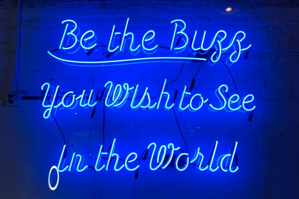 neon sign be the buzz you wish to see in the world | 7 Easy Ways to Build a More Positive Mindset https://positiveroutines.com/positive-mindset/