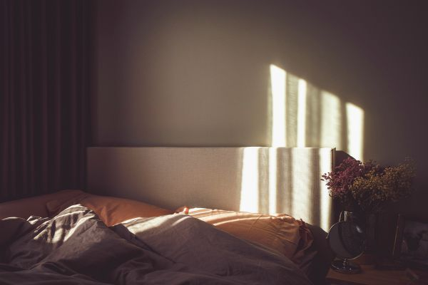 sun soaked bed with messy sheets | How to Take Advantage of a Flexible Schedule https://positiveroutines.com/flexible-schedule-tips/