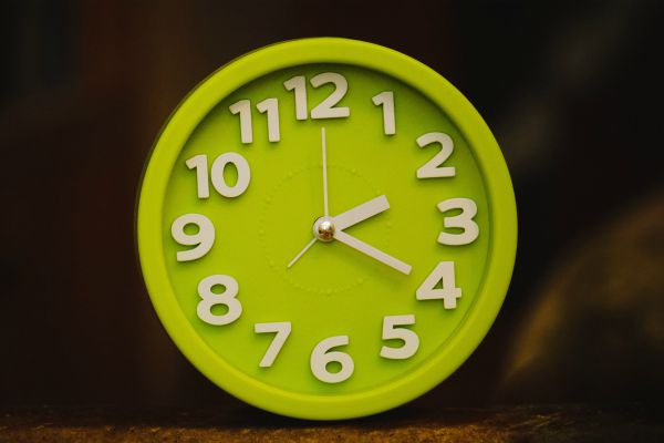 "bright green analog clock | How to Stop Feeling Guilty For Not Getting ""Enough"" Work Done https://positiveroutines.com/stop-feeling-guilty/"