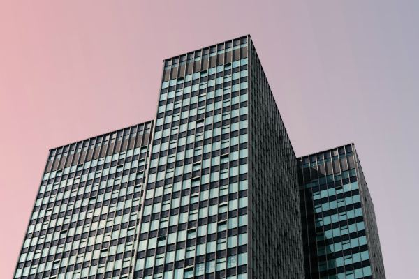 office buildings in sunset | How to Leave Work at Work and Actually Enjoy the Weekend https://positiveroutines.com/enjoy-the-weekend/